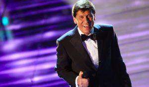 Robbie WIlliams vs Gianni Morandi: i due cantanti contro a Sanremo 2011