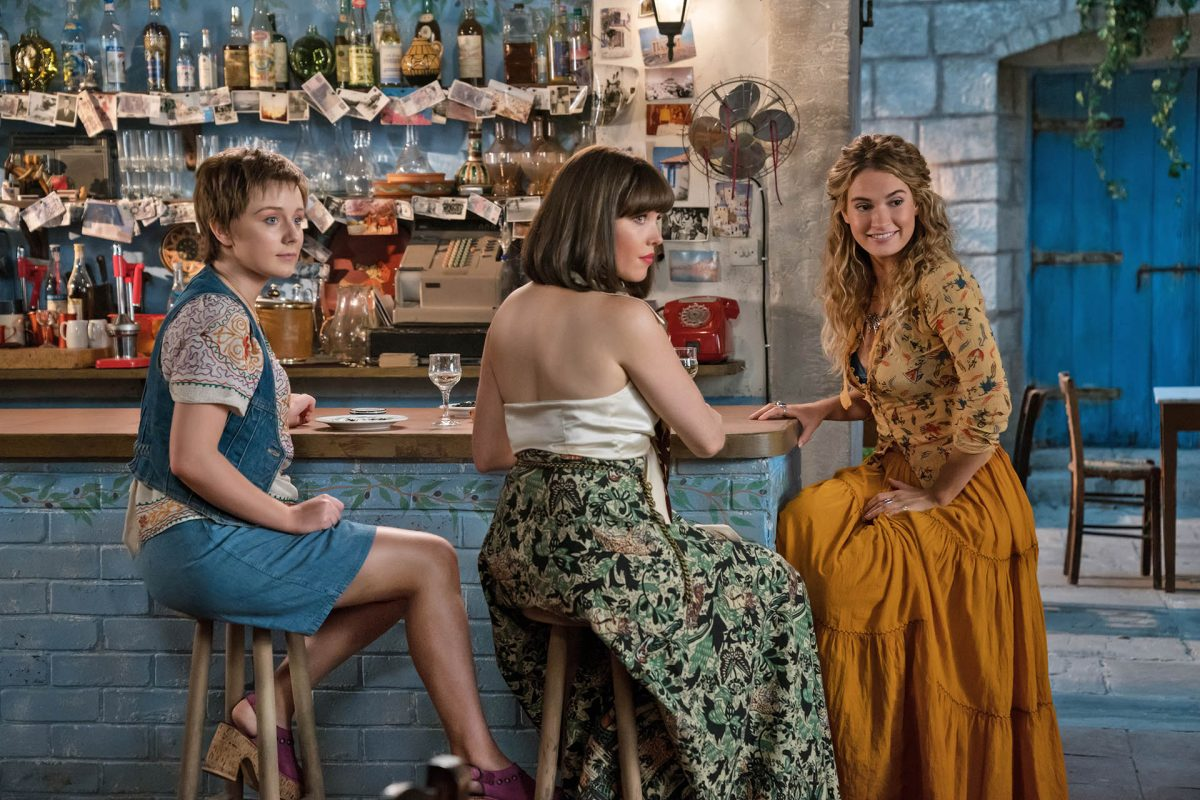 """(L to R) Young Rosie (ALEXA DAVIES), Young Donna (LILY JAMES) and Young Tanya (JESSICA KEENAN WYNN) in """"Mamma Mia! Here We Go Again."""" Ten years after """"Mamma Mia! The Movie,"""" you are invited to return to the magical Greek island of Kalokairi in an all-new original musical based on the songs of ABBA."""