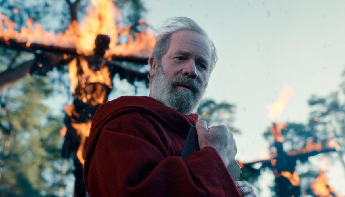 CURSED (L to R) PETER MULLAN as FATHER CARDEN in episode 101 of CURSED Cr. COURTESY OF NETFLIX © 2020