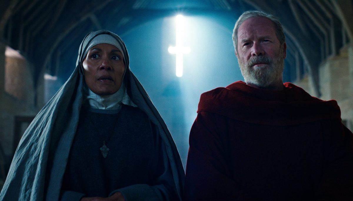 CURSED (L to R) CAROLINE LEE JOHNSON as ABBESS NORA and PETER MULLAN as FATHER CARDEN in episode 103 of CURSED Cr. COURTESY OF NETFLIX © 2020
