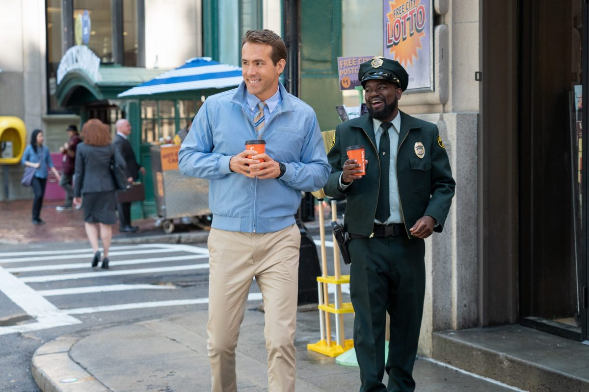 Ryan Reynolds as Guy and Lil Rel Howery as Buddy in 20th Century Studios' FREE GUY. Photo by Alan Markfield. © 2020 Twentieth Century Fox Film Corporation.  All Rights Reserved.