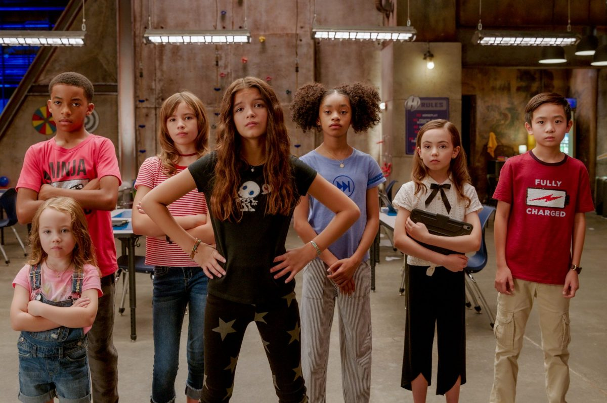 We Can Be Heroes: (L-R)  Vivien Blair as Guppy, Isaiah Russell-Bailey as Rewind, Lotus Blossom as A Capella, YaYa Gosselin as Missy Moreno, Akira Akbar as Fast Forward, Hala Finley as Ojo, Dylan Henry Lau as Slo-Mo. Cr. Ryan Green/NETFLIX © 2020