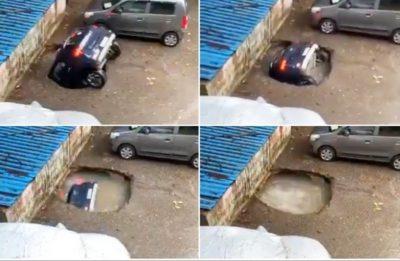automobile inghiottita voragine