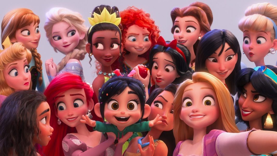 """SELFIE! – In """"Ralph Breaks the Internet,"""" Vanellope von Schweetz hits the internet where she encounters and then befriends the Disney princesses. Filmmakers invited the original voice talent to return to the studio to help bring their characters to life, including Sarah Silverman (Vanellope in """"Ralph Breaks the Internet""""), Auli'i Cravalho (""""Moana""""), Kristen Bell (Anna in """"Frozen""""), Idina Menzel (Elsa in """"Frozen""""), Kelly MacDonald (Merida in """"Brave""""), Mandy Moore (Rapunzel in """"Tangled""""), Anika Noni Rose (Tiana in """"The Princess and the Frog""""), Ming-Na Wen (""""Mulan""""), Irene Bedard (""""Pocahontas""""), Linda Larkin (Jasmine in """"Aladdin""""), Paige O'Hara (Belle in """"Beauty and the Beast""""), and Jodi Benson (Ariel in """"The Little Mermaid""""). ©2018 Disney. All Rights Reserved."""